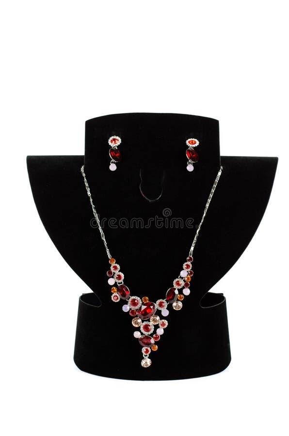 Halsband med hängen och örhängen fotografering för bildbyråer