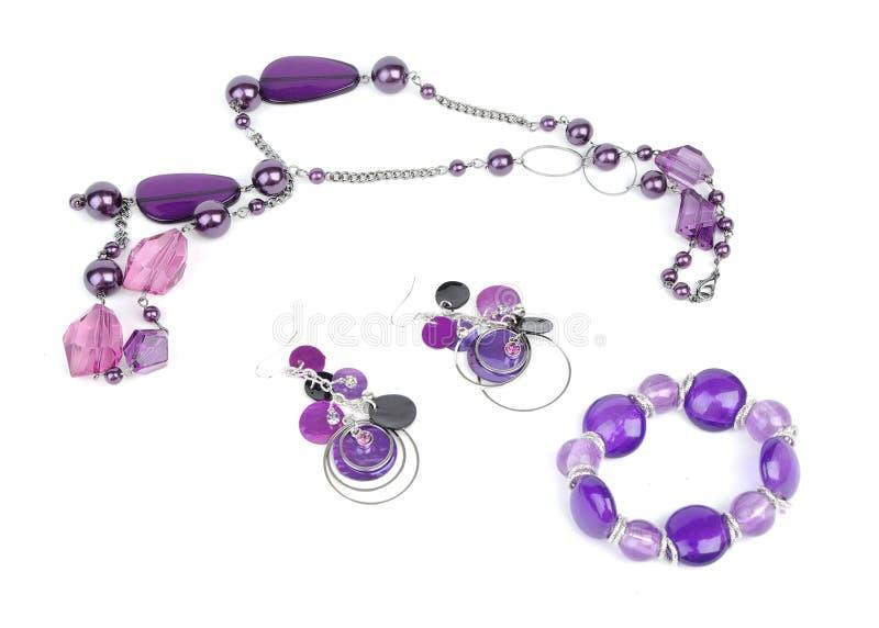 Halskette, Armband und Ohrring stockfotos