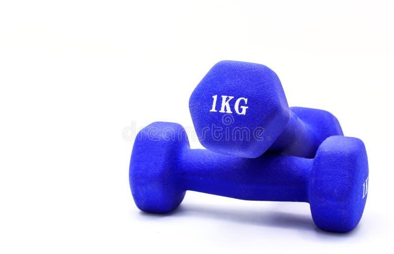 Haltères pesant un kilogramme pour l'exercice photo stock