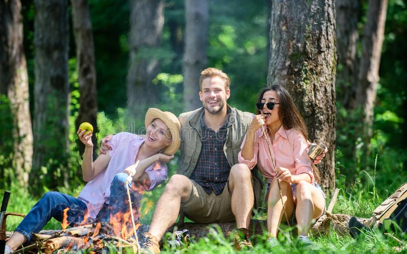 Halt for snack during hiking. Company hikers relaxing at picnic forest background. Camping and hiking. Relax and fun in stock images