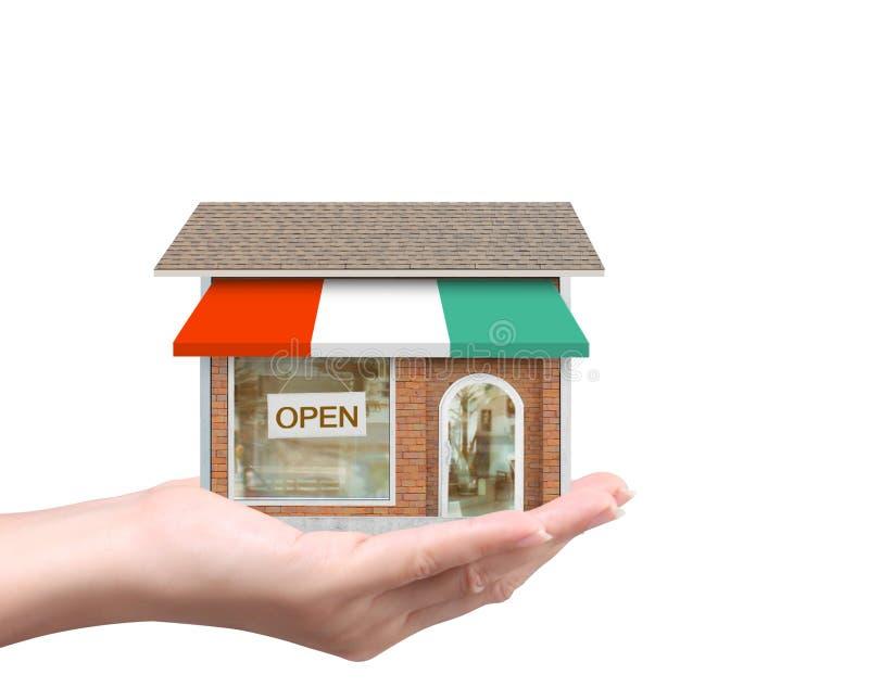 Halten des Hauses, das Wohneigentum darstellt lizenzfreies stockfoto