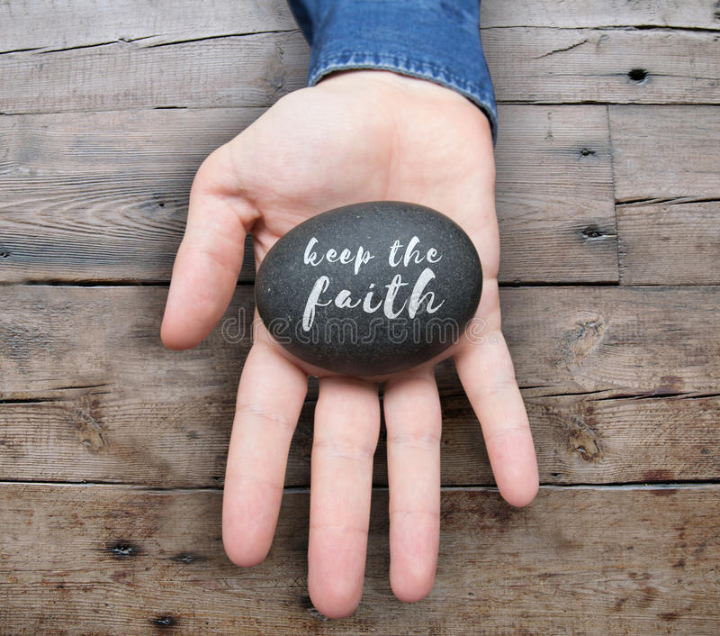 Halten Sie den Glauben stockbilder
