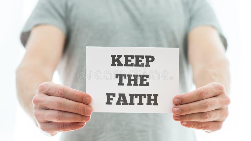 Halten Sie die Glaubenmitteilung stockfoto