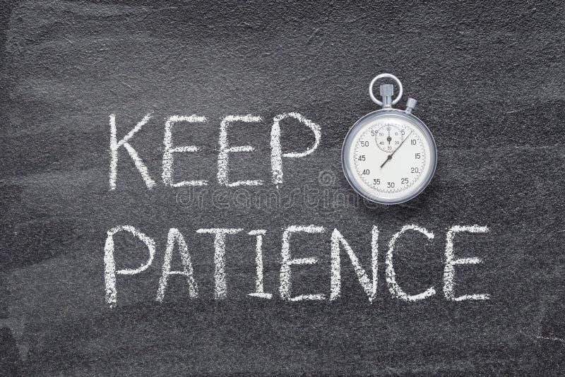 Halten Sie Geduldsuhr lizenzfreies stockbild