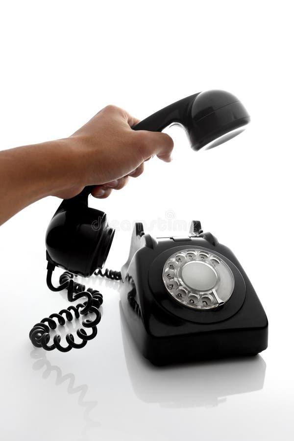 Halten Sie Telefon an lizenzfreies stockbild