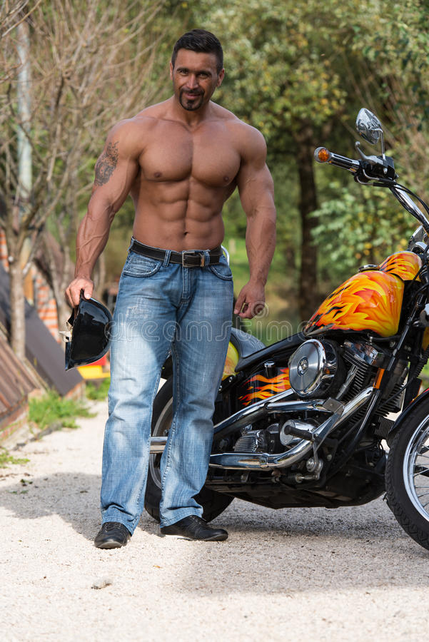 Halterofilista e motocicleta imagens de stock