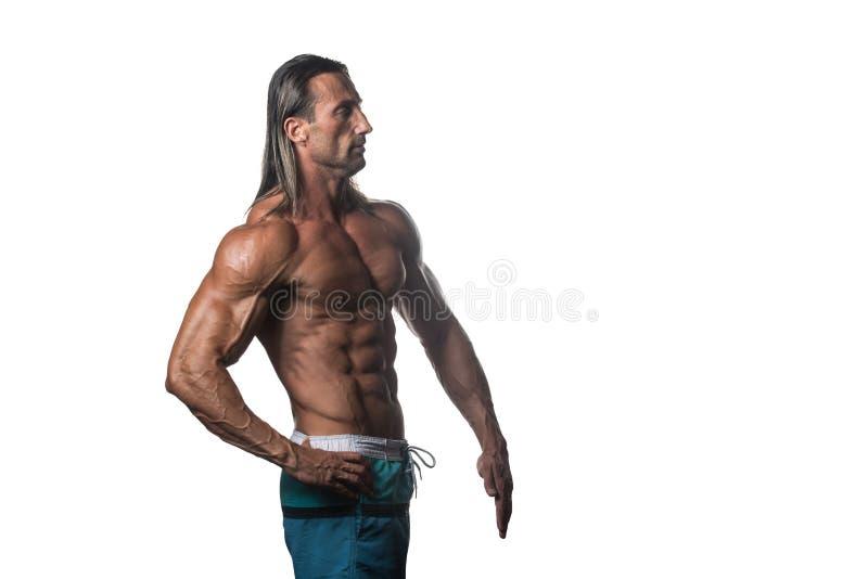Halterofilista muscular Guy Posing Over White Background fotos de stock royalty free