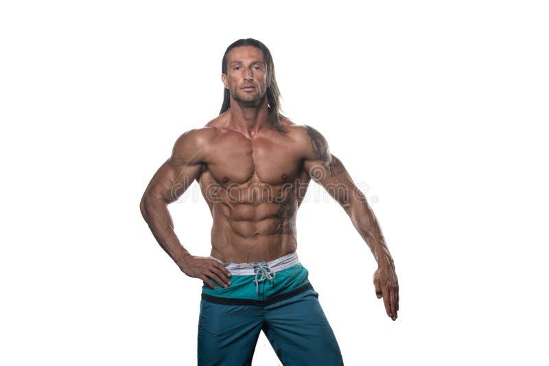 Halterofilista muscular Guy Posing Over White Background imagem de stock