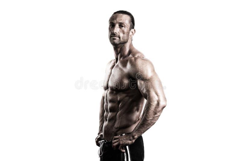 Halterofilista muscular Guy Posing Over White Background foto de stock
