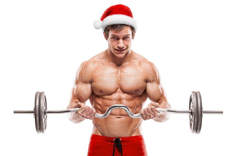 Halterofilista muscular Santa Claus que faz exercícios com pesos imagens de stock royalty free