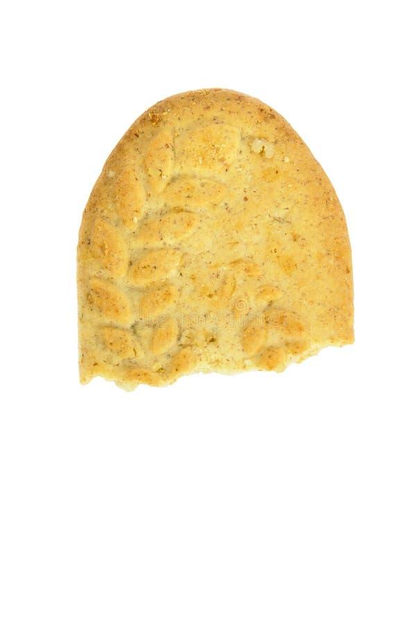 Halva ätit kex på vit bakgrund arkivbild