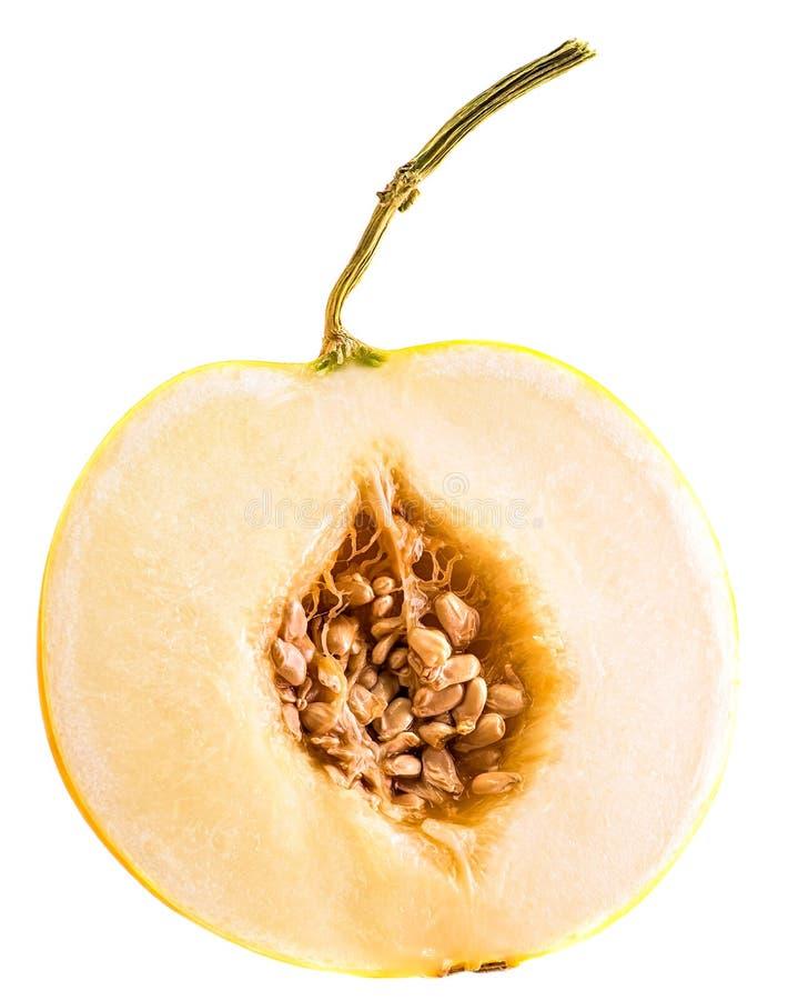 Halva av den gula melon med frö som isoleras på vit bakgrund royaltyfria foton