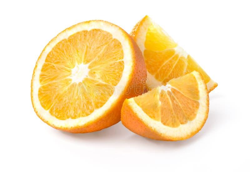 Halva och två segment för orange frukt royaltyfria bilder