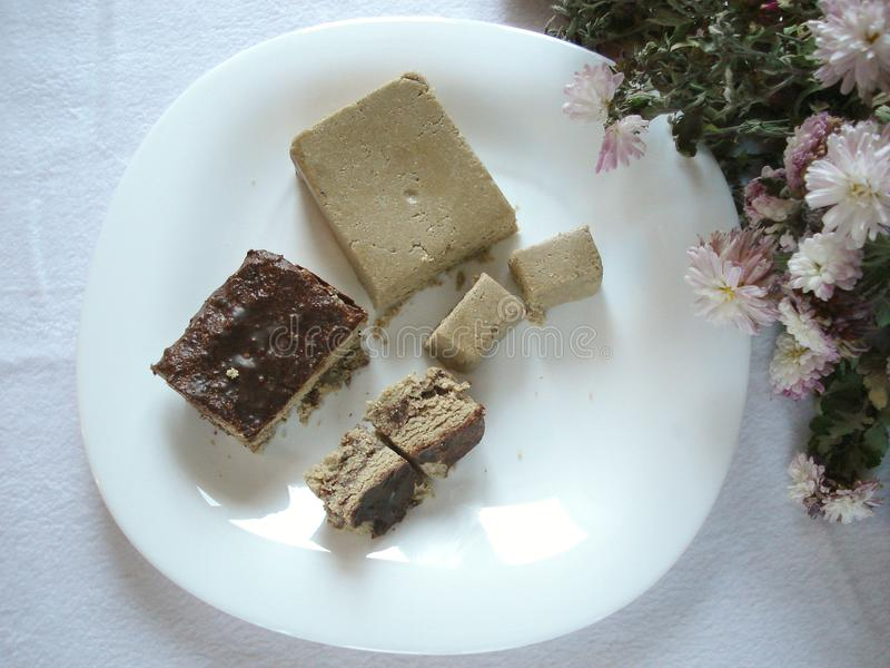 Halva on a plate, top view. stock image