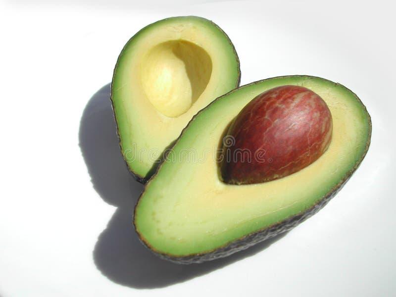 Halve avocado stock afbeelding