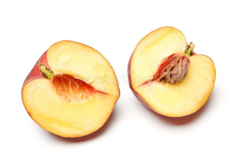 halved персик стоковая фотография