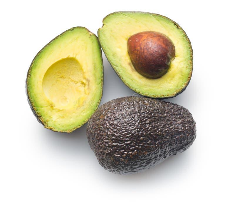 Halved avocado. On white background royalty free stock photo