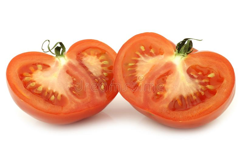 Halved beef tomato. On a white background royalty free stock photo