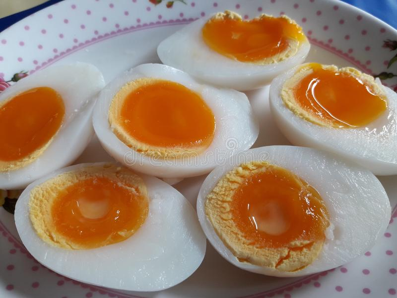 Halved boiled eggs. Eaten with other Thai food stock photo