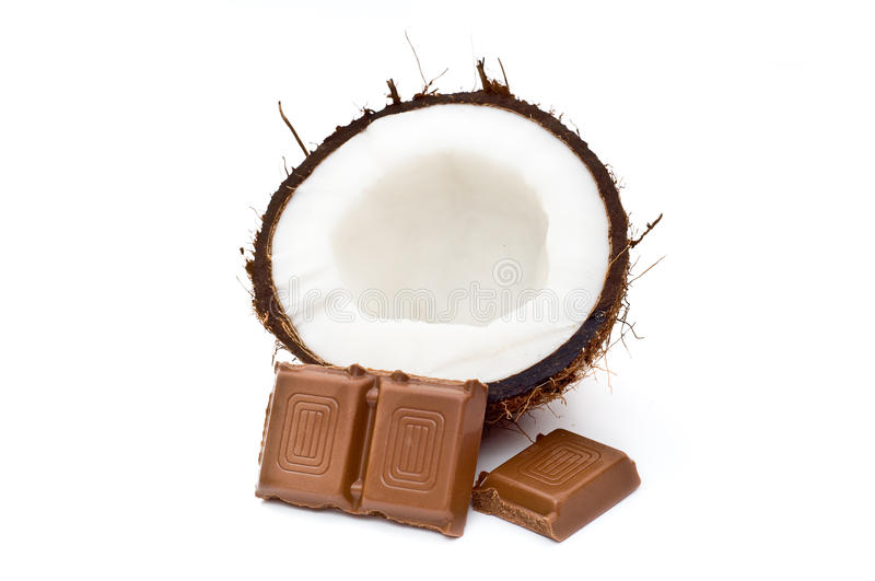 Halved coconut with chocolate. Blocks isolated on white royalty free stock images