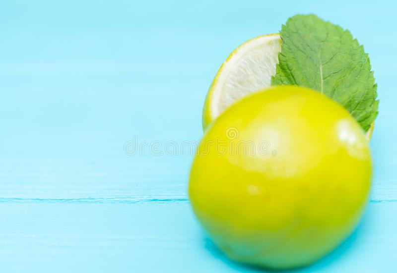 Halved fresh lime or lemon with mint royalty free stock photo