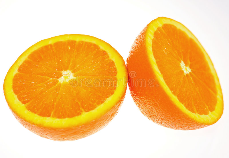 Halved fresh orange. Isolated on white background stock images