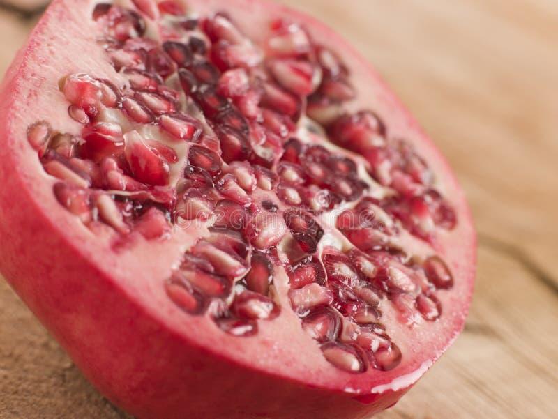 Halved Fresh Pomegranate. Close Up Of Halved Fresh Fig royalty free stock photos