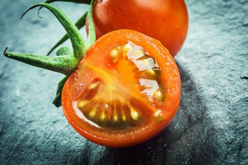 Halved juicy fresh grape tomato stock photo