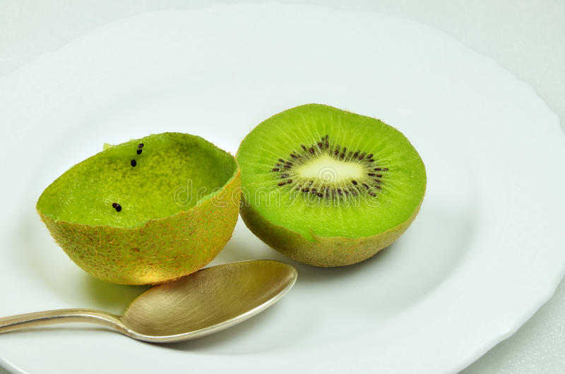 Halved Kiwi Fruits royalty free stock photos