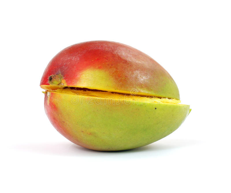 Halved mango. An interesting colorful view of a halved mango royalty free stock photos