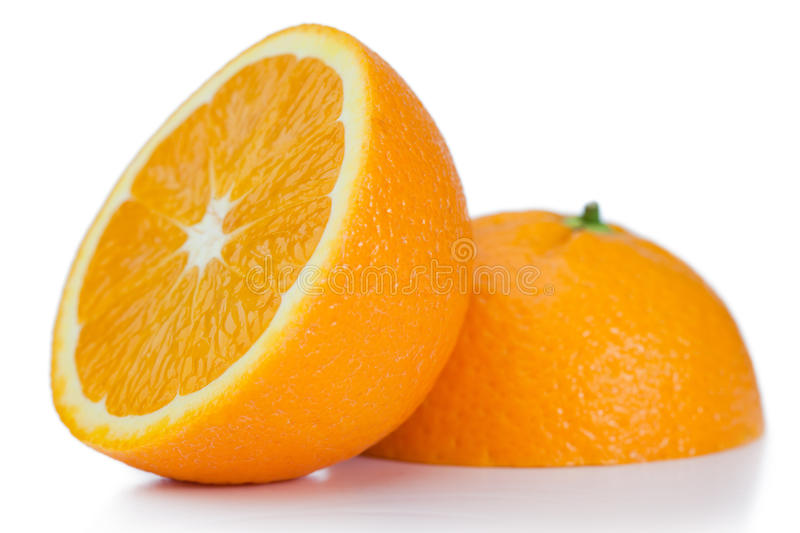 Halved orange. On a white background royalty free stock images