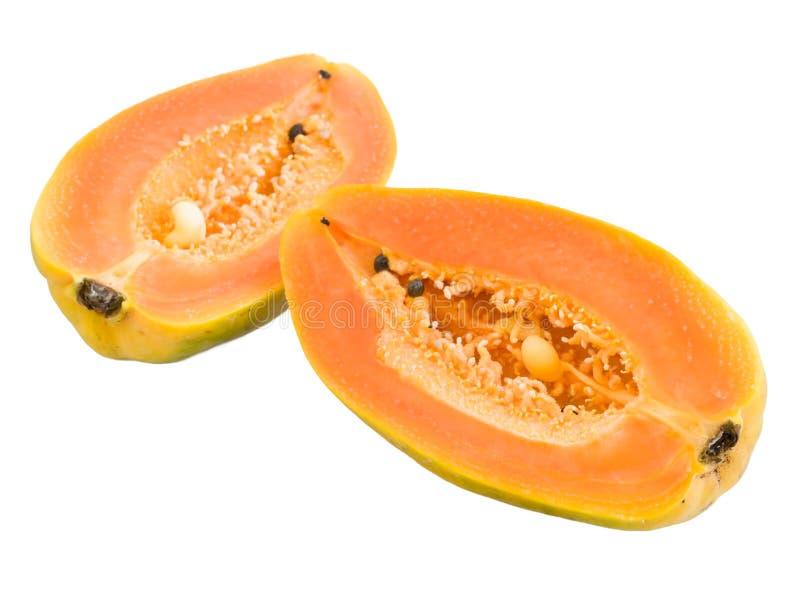 Halved Papayas. Halved seedless Hawaiian papayas isolated and with clipping path stock photo