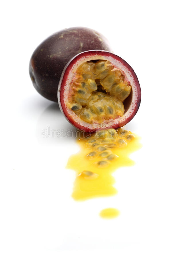 Halved passion fruit on white background royalty free stock photos