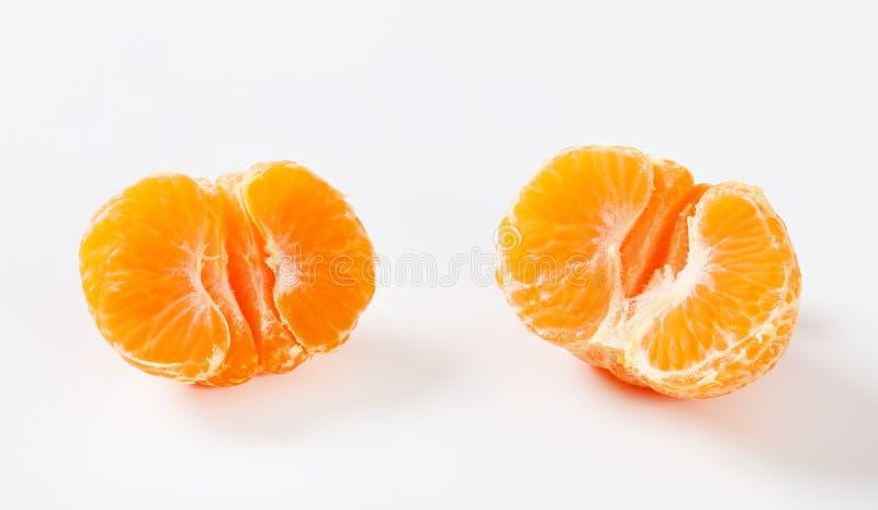 Halved peló la mandarina imagen de archivo libre de regalías