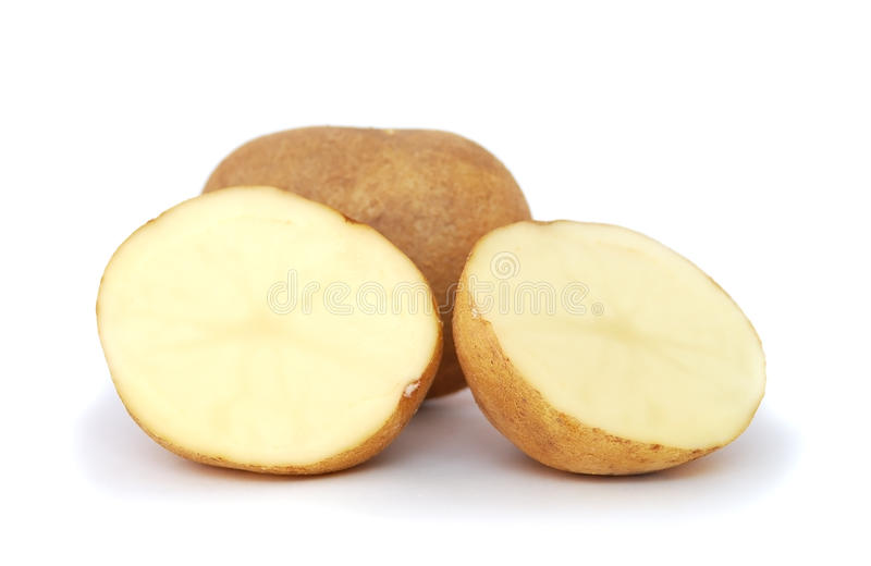 Halved potato. Close-up of raw halved potato on white background stock photography