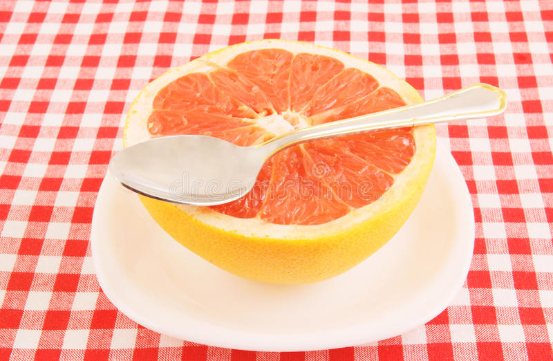 Halved Red Grapefruit On Tablecloth Stock Photos