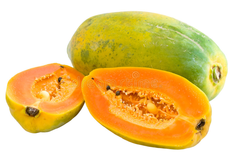 Halved and Whole Papayas. Halved and a whole seedless Hawaiian papayas isolated and with clipping path stock images