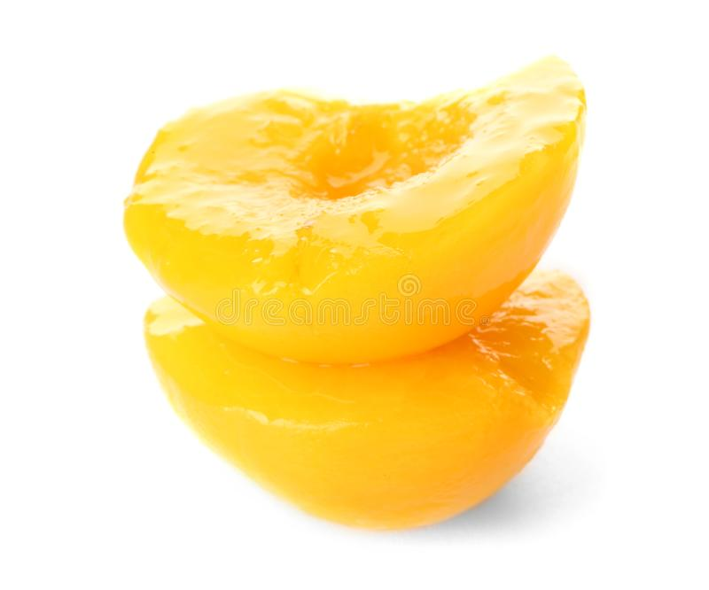 Halves of canned peach. On white background stock image