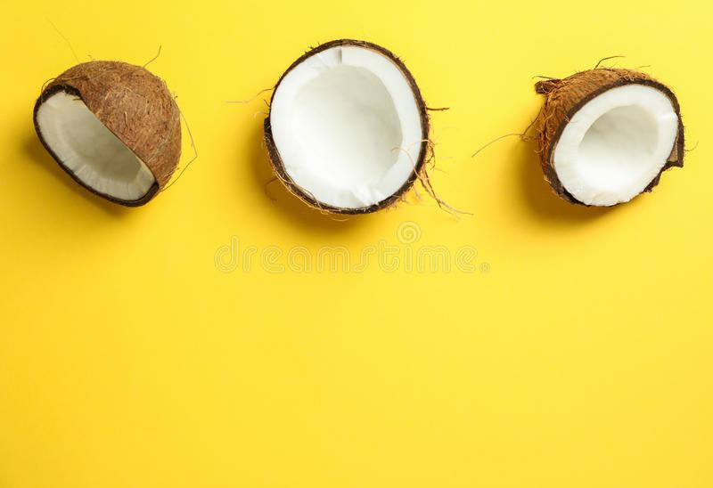 Halves coconut on color background stock photo
