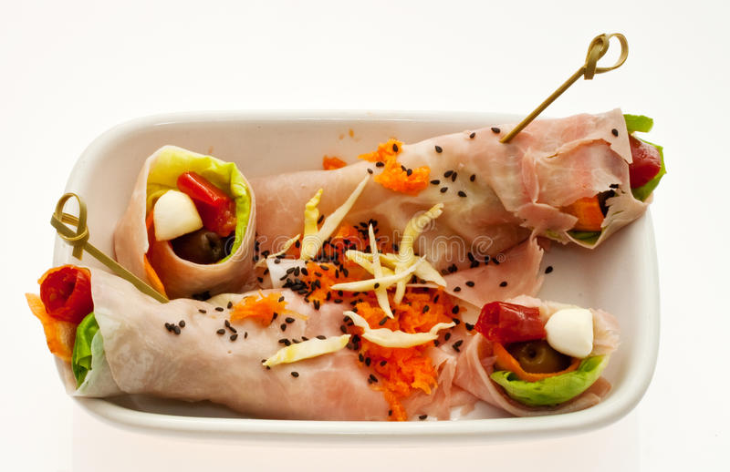Ham. Stuffed wuth various vegetables inside a dish. Isolated on a whitw background stock images