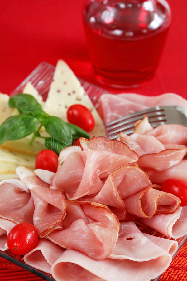 Ham. Sliced ham on plate in red tone stock image