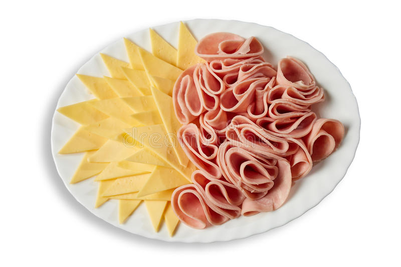 Ham and cheese on dish. Isolated royalty free stock image