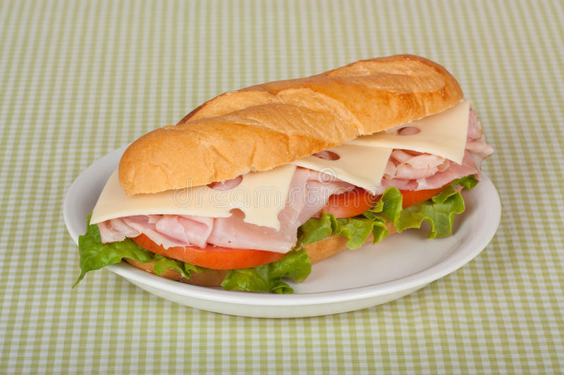 Ham and Cheese Sandwich. Ham and swiss cheese sub sandwich with lettuce and tomato on a bun stock image