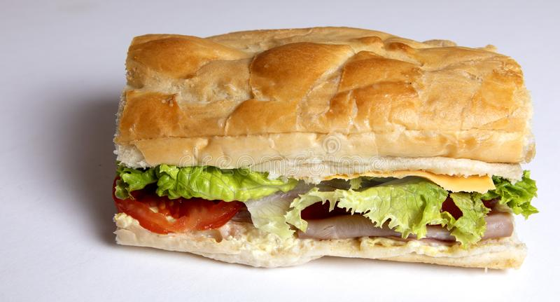 Ham and cheese Po Boy Sandwich with lettuce. Ham and Cheese sandwich on PoBoy bread with lettuce and mayo stock photos