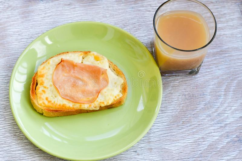 Breakfast. Ham and Cheese Sandwiches and fruit juice royalty free stock images