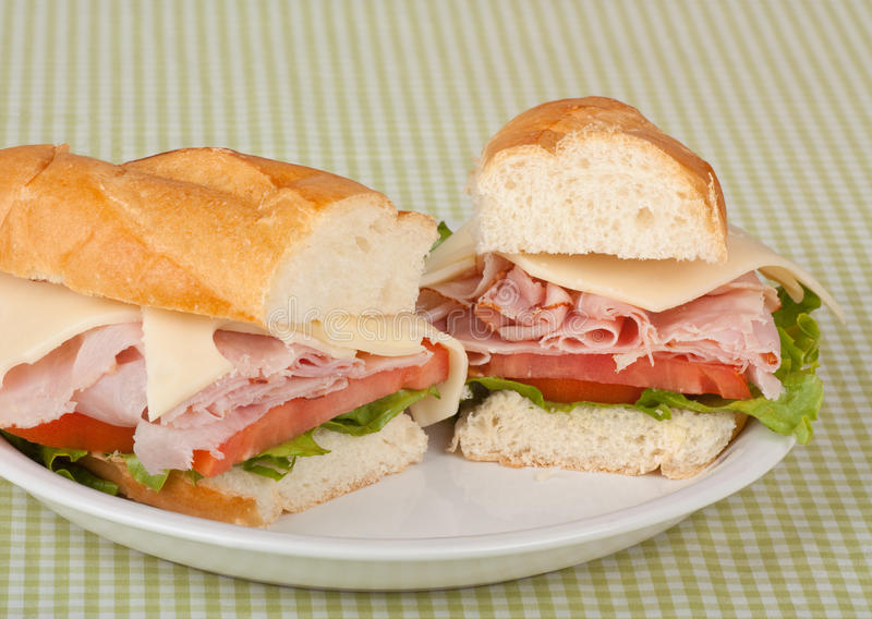 Ham and Cheese Sub. Ham and swiss cheese sub sandwich with lettuce and tomato on a bun stock photography