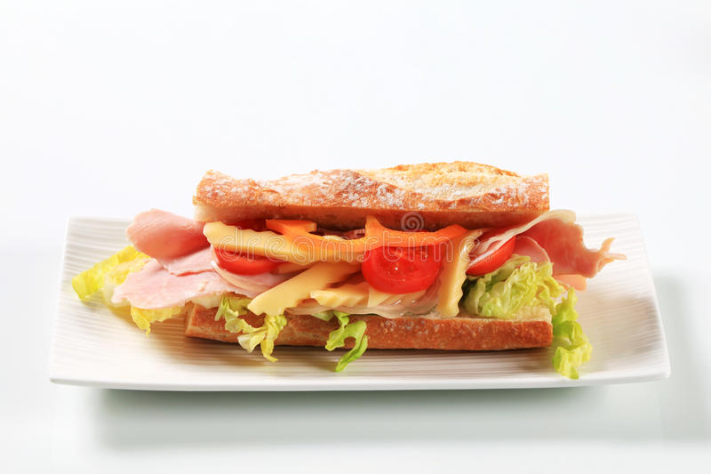Ham and cheese sub sandwich. Studio shot royalty free stock image