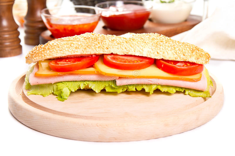 Ham and cheese sub. On a wooden board stock image