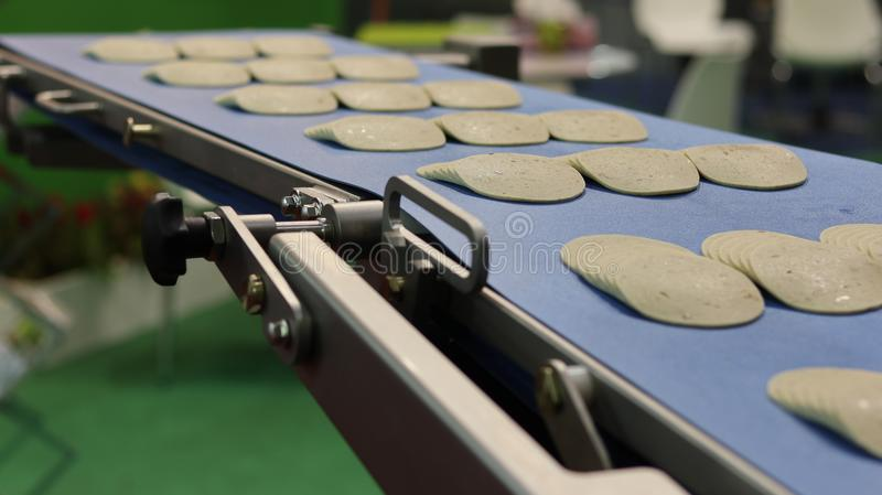 Ham on conveyor belt ;. Cutting ; slice ; machine stock photography