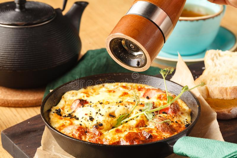 Ham and egg omelette, bio eggs, fresh herbs stock photo